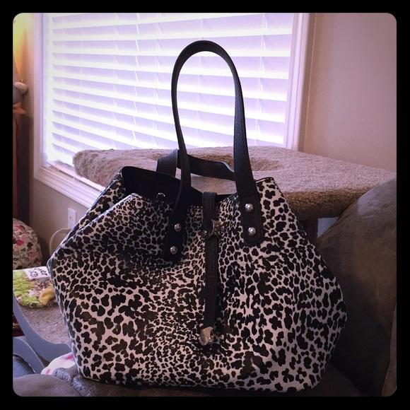 66e83d0dfc7d6c Charming Charlie Handbags - Charming Charlie snow leopard kangaroo bag! Mint